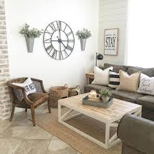 decor tips for living rooms. Interesting Rooms Living Room Wall Decor Oversized Clock Vases And U201cstayu201d Sign  SPJQPCO For Decor Tips Living Rooms