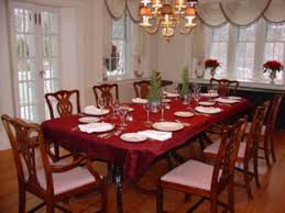 green formal dining room presenting some vintage dining chairs side support base legs round glass tables