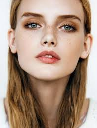 on your eyes use c lipstick to draw out the color of your freckles and to look natural and quirky of course other bold shades would also work