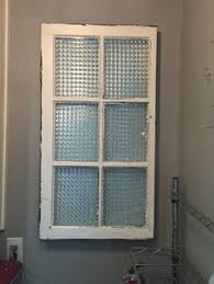 antique window turned power panel cover! (she natalie antique wooden fuse box cabinet at Covering Fuse Box Ideas