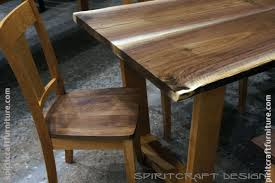 solid hardwood dining table from slabs of kiln dried black walnut with mid century modern style