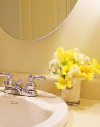 The simple addition of a small bouquet in this traditional bathroom gives a  warm and cosy vibe. Image Source (source). bathroom fresh flowers