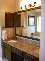 Bathroom. brown polished wooden Bathroom Double Vanity with marble top and  round white sink also