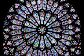notre dame s rose windows lit up from behind