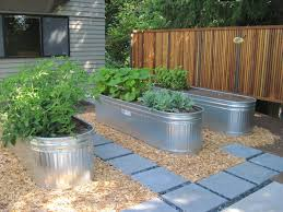 5 galvanized water trough planters for a clean look