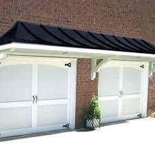 garage door overhang kit porch overhangs photo 3 of 6 metal roof above doors neighbours glamorous front door overhang