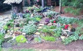outdoor fairy garden with rocks and shrubs solar lights supplies
