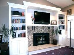 tv cabinet above fireplace unit with fireplace cabinet over fireplace tv stands with fireplace inserts