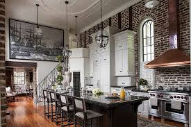 ... Sweeping Victorian kitchen with high ceiling, brick wall backdrop and  an air of dramatic flair