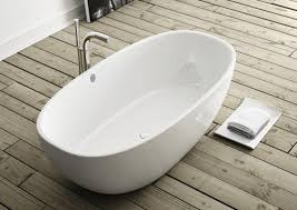 above victoria and albert s barcelona double ended tub is made of englishcast a blend of volcanic limestone and high performance resins that results in a