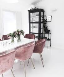 so into these velvet chairs in this minimalist setting velvet dining room