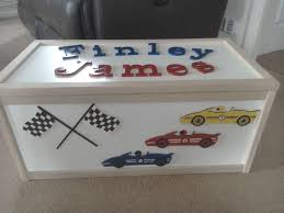 large wooden racing car decorated toy box with child s name on lid l71cm w36cm