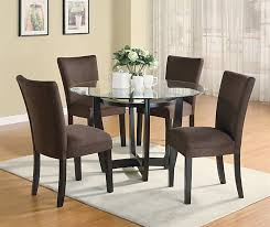 modern round dining room set with brown chairs