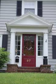 Front Porch Great Home Exterior Design With Small Front Porch Using Round  White Pillars And Single Red Brown Glassed Door Combine With Red Brick  Floor And ...