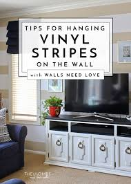 vinyl stripes on the wall in the family room walls need love