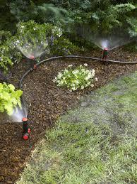 garden irrigation system. Snip-n-Spray Garden And Landscape Sprinkler System Spraying Water On Flowers Shrubs Irrigation S
