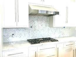 marble tile backsplash kitchen