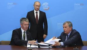 bp rosneft to jointly seek russian shale oil igor sechin right and bp russia head david campbell signing documents during a ceremony