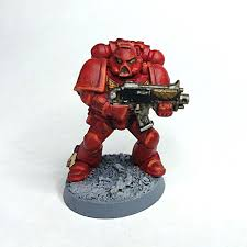 new to 40k practice blood angel tactical marine to figure out painting technique