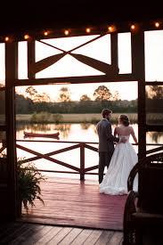 bride and groom lakeside at at vine wedding venue in georgia
