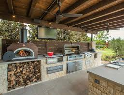 stone woodfired outdoor kitchen