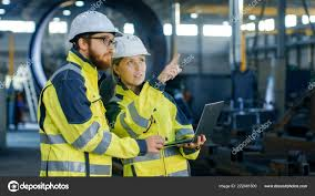 Portrait Male Female Industrial Engineers Hard Hats Discuss New