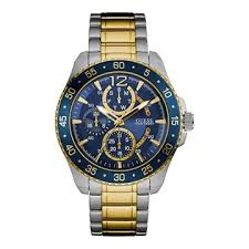guess men s watches buy now from an official uk stockist guess men s silver gold watch a blue dial
