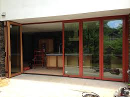 riveting red trim door accordion screen doors lacantina doors cost accordion sliding glass doors custom bif