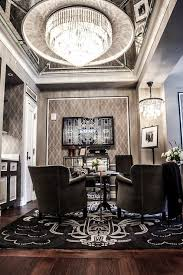 new york plaza hotel gray living room with mirrored ceiling punctuated with restoration hardware 1920s odeon glass fringe 7 ring chandelier iron over