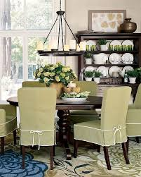 love the dining room love the green slip covers great rug and light fixture love it all