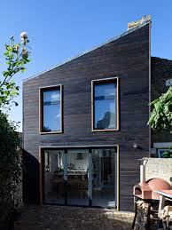 Chris Dyson adds blackened wood extensions to London house
