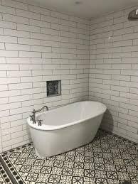 how a customer created a tile rug in the bathroom shower area