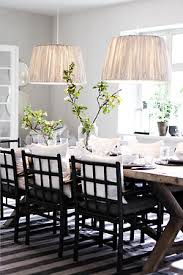 fantastic monochromatic dining e with weathered x base table striped rug a pair of pendants and black dining chairs this ls from danish tine k
