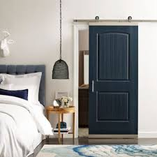 room door designs. Black Sliding Barn Door In A White Room With Bed Comforter And Designs