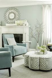 The celestial airiness of walls lacquered in Benjamin Moore's Antiguan Sky  is grounded by a pair