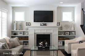 bookshelves that look like built ins surrounding a fireplace make your fireplace built ins