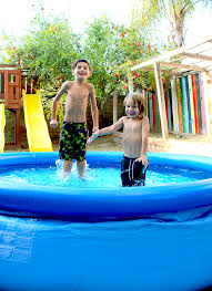 Backyard pool with slides Rock Backyardkidspool Wooden Pool Plunge Pool Swimming Fun With Backyard Ocean Popsicle Blog