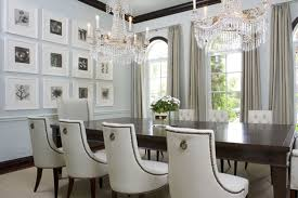 crystal chandelier with candles for rectangular dining room table design using elegant white curtains ideas