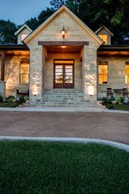 Oklahoma Flagstone clad stairs, gas lamp, shell and austin stone facade and  cedar beams