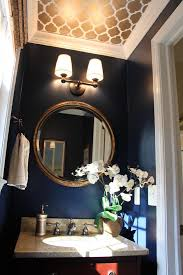 love the idea of a dark color and a gold mirror