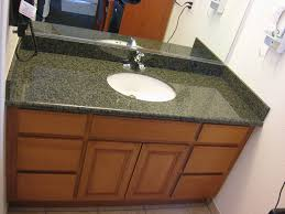 motel bathroom counter top and cabinets