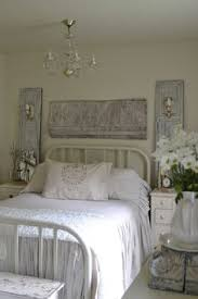 mismatched bedroom furniture. shutters are standing behind side tables each has an attached sconce for lighting wall mismatched bedroom furniture