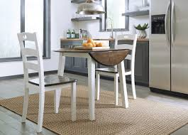 woodanville round drm drop leaf table 2 dining room side chairs