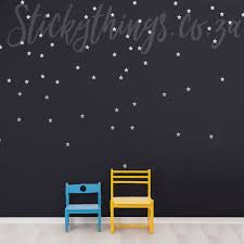 silver shooting stars pattern wall decals on a dark wall