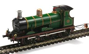below is the pretty bachmann wainwright c with its new metal chimney supplied by south east finecast fitted complete with seuthe smoke generator