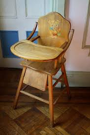 vintage wooden high chair with tray it looks much sturr than the ones you can get now a days