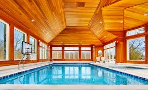 mansion with indoor pool with diving board. Contemporary Indoor Swimming Pool With Exposed Finishes Halogen Lights Basketball Backboard Plenty Windows Mansion Diving Board