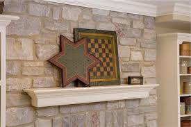 stone fireplace with crown molding fireplace detail of suspened mantel on a stone fireplace