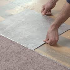 laying first tile along layout line