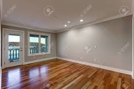 wall paint colors. Empty Room Interior With Soft Grey Walls Paint Color, Glossy Hardwood Floor And Door To Wall Colors O